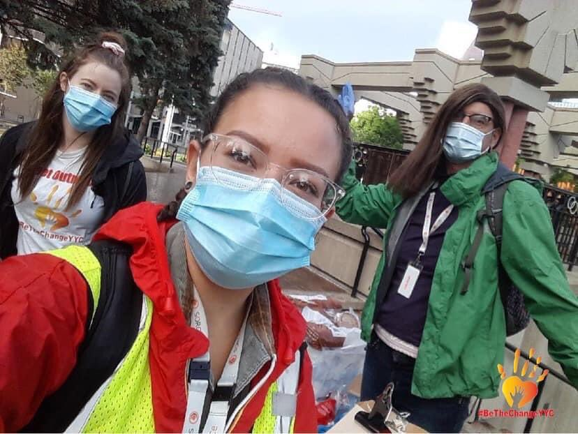 Sara McGilvery, Hanna Woodward, and Chris Macnab in Olympic Plaza Calgary  on homeless street outreach.